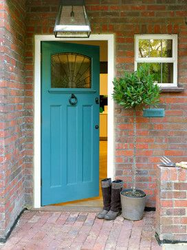 Fresh front door – such a nice contrast against the red brick.   The color is Teal Ocean, by Benjamin Moore.