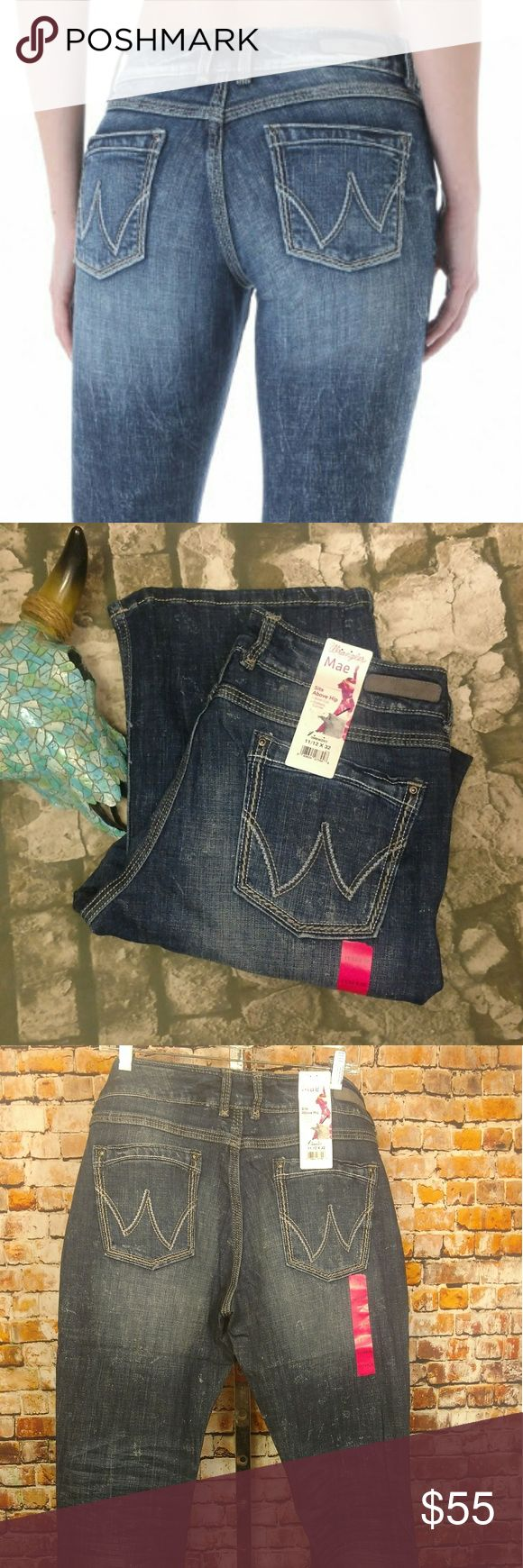 NWT Wrangler Mae Bootcut Jeans 11/12 X 32 Ladies Wrangler premium patch a fit,  bootcut jeans. style # 09 MWZRT. Sits above hip, Slimmer fit through thigh and butt, mid-rise, bootcut. Stonewash makes every pair of these jeans uniquely different. 64% cotton 19% rayon 16% polyester 1% spandex. Dark stonewash. Photos are representative of all sizes available. 11/12 X 32 Wrangler Jeans Boot Cut