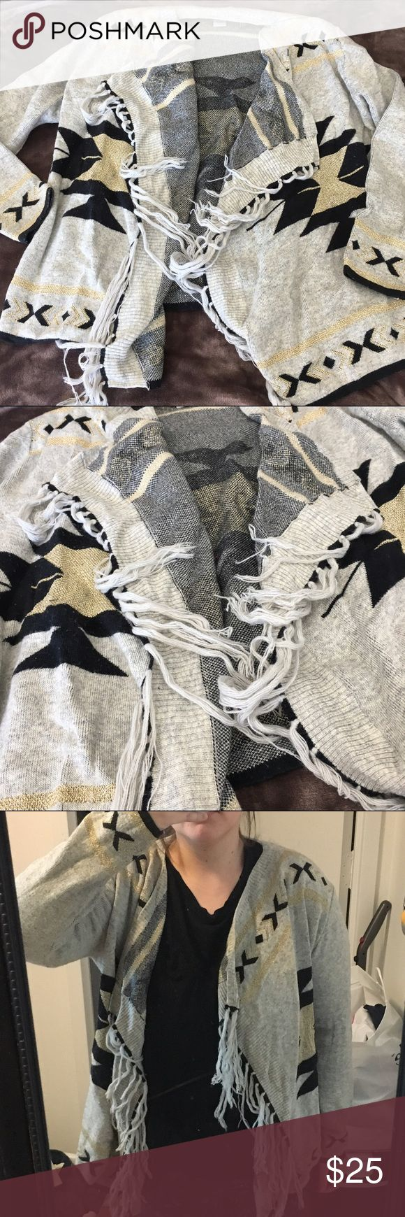 • Frayed Tribal Sweater • Swinging open face tribal sweater with frayed edges. The sweater is a light grayish color with black and gold design. Great condition! Sweaters Cardigans