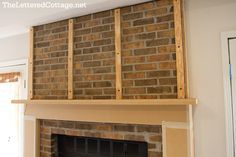 fireplace makeover, the lettered cottage, horizontal planking fireplace, wood over brick fireplace, fireplace before and after, fireplace redo, vero beach interior designer, cute and company