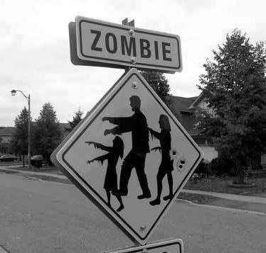 Zombies... I actually saw this sign last year somewhere!                         http://survivalcoursesinfo.com/