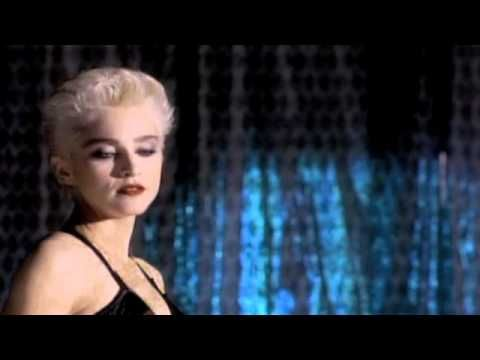"Madonna - Open Your Heart I will never forget the first time I saw this video!It was the first I said out loud ""Oh My GOD!I'm in love with this woman!"" A CLASSIC!!"