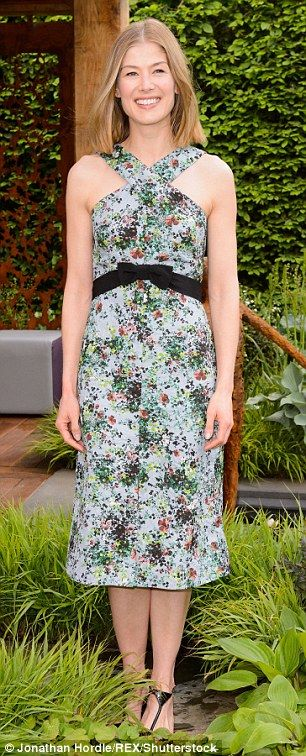 Flower power: Rosemund Pike looked sensational in a midi-length floral number...