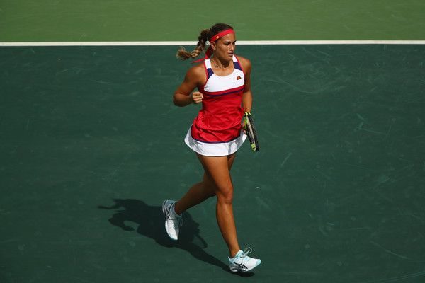 Monica Puig Photos - Monica Puig of Puerto Rico celebrates a point against Petra Kvitova of the Czech Republic during the Women's Singles Semifinal on Day 7 of the Rio 2016 Olympic Games at the Olympic Tennis Centre on August 12, 2016 in Rio de Janeiro, Brazil. - Tennis - Olympics: Day 7