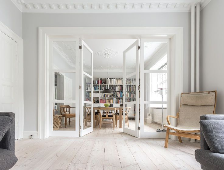 Folding door separating two living rooms. Each door folds on the middle. Vahle…