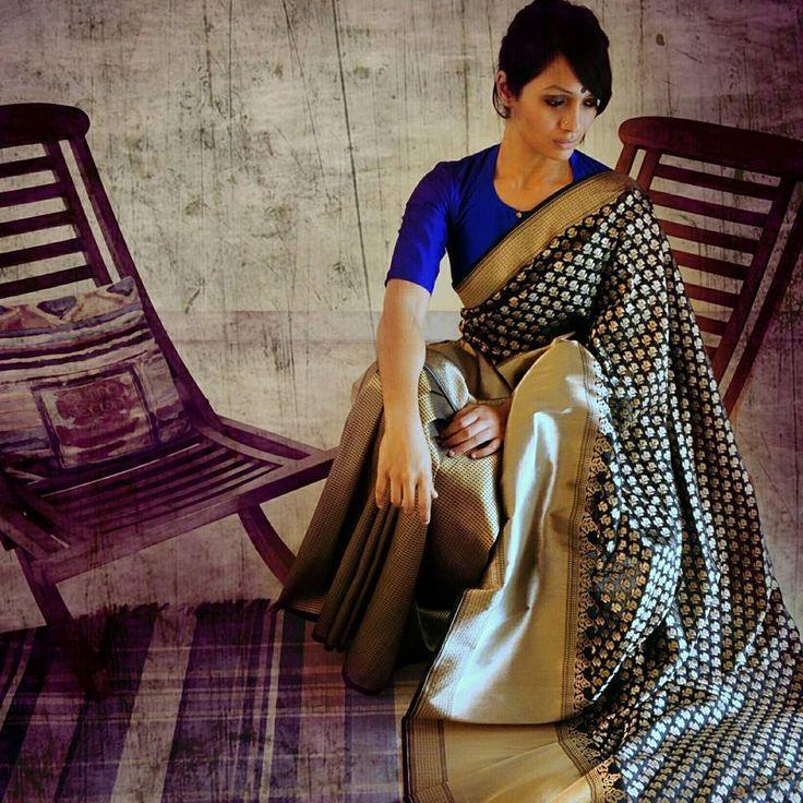 Bhang: Dull gold zari partly pallu sari with black brocade and broad zari bordered pallu