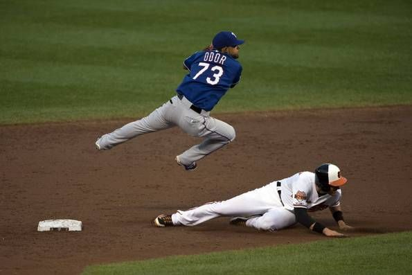 Rougned Odor leaps over third baseman Ryan Flaherty to complete a double play in the third inning a Rangers' game July 2 v the Orioles. Mandatory Credit: Tommy Gilligan-USA TODAY Sports