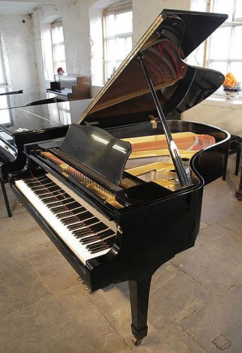 A 1975, Yamaha G3 grand piano for sale with a black case and spade legs at Besbrode Pianos