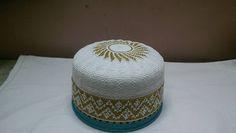 geometric design with sun top bohra white golden topi