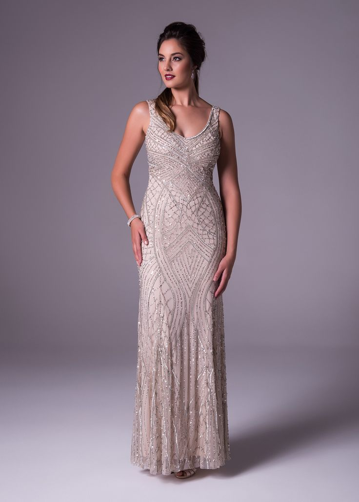 Oleg Cassini does it again in this timeless champagne fully beaded chiffon gown. It's slimming soft silhouette shows off your curves and is appropriate for any special occasion. Available exclusively at Bride&co: http://www.brideandco.co.za/product/new-collection/wgin0042/
