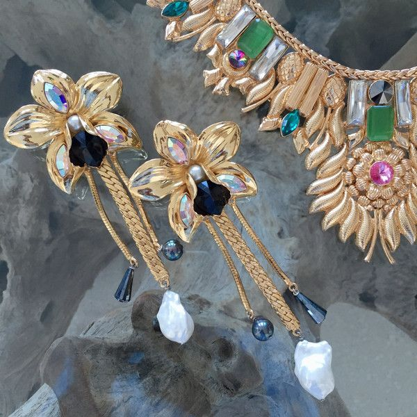 $184 HAUTEEDIT.COM - 18Kt Gold Plated Brass OrchidEarrings Valliyan by Nitya Arora. An exquisite range ofsculptural, one of a kind jewellery handcrafted in India with semi-precious stones and Swarovski crystalsto give pieces life and texture.