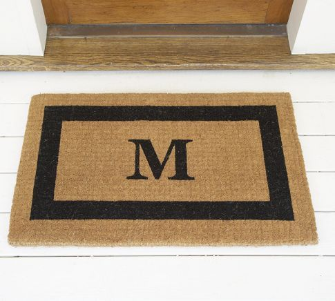 Totally coveting this welcome mat for our new home... only with the right monogram, of course.