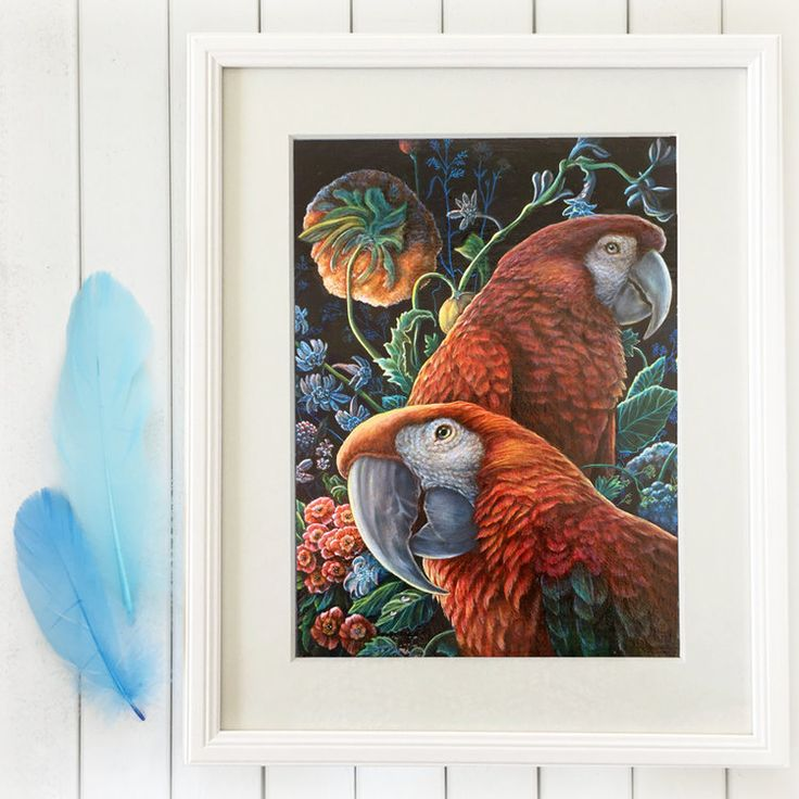 Two beautiful macaw parrots in a pretty garden of fresh flowers.