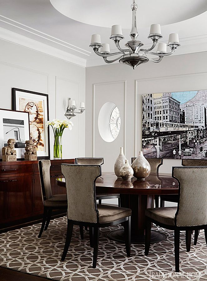 A Charming Oval Window Was Inset Into A Dining Room Wall