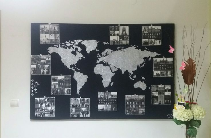 DIY wall decor world map picture in black canvas and silver golddust with pictures from my vacation destinations.