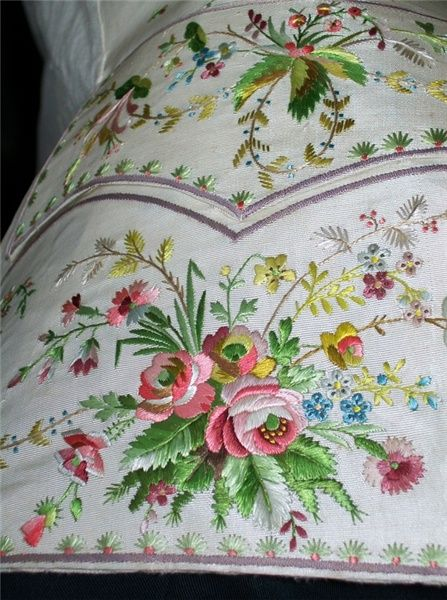 Georgian cream grosgrain silk waistcoat, embroidered with honeysuckle, roses, pinks & forget-me-nots. Costume collection, Paxton House, Scottish Borders, UK.
