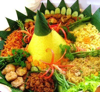 Nasi Kuning, traditional Indonesian dishes usually served on special occasion such as birthdays, graduations, house warming, birth, etc