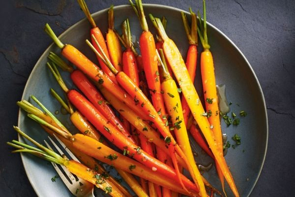 A little butter, honey and a few spices create a wonderfully aromatic glaze for these cardamom- and ginger-glazed carrots. Try using a mix of orange and yellow carrots for a colourful presentation. Photo by Jodi Pudge.
