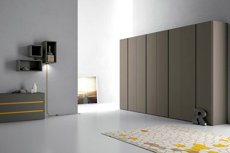 Modern Italian sliding door closet system. Visit our showroom for more details or call us at 718-434-2111