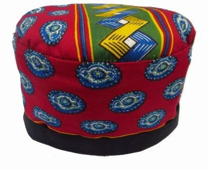 A unique handmade pill box hat in a soft cotton fabric with a lightly padded crown and a full black inner. Fully reversible and ideal for travelling.