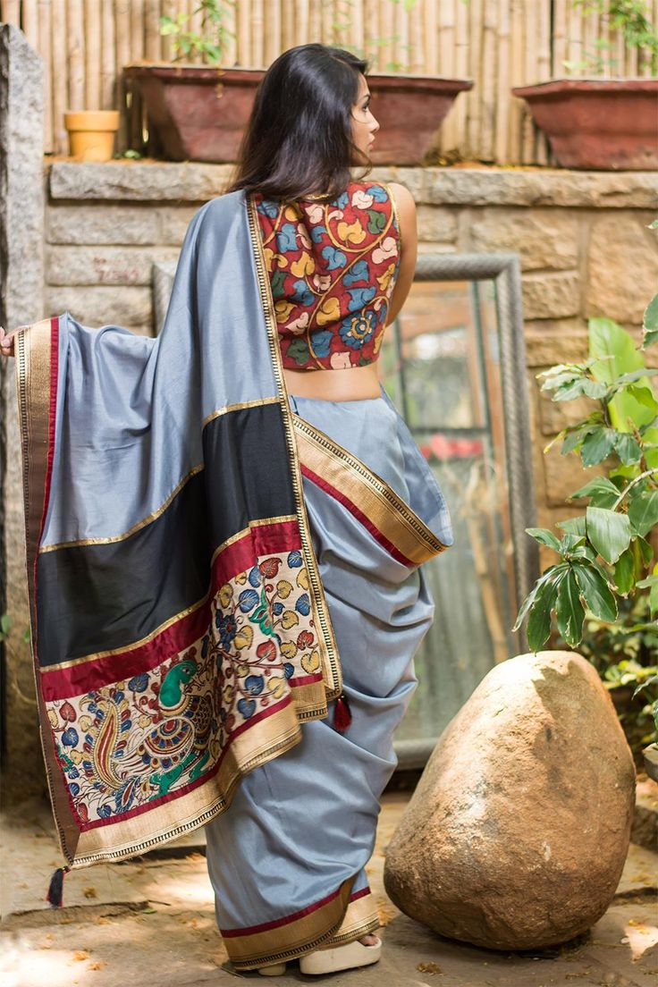 Neither black nor white. Grey…the magical midtone! A truly complimenting semi silk saree in grey with a black gold brocade border edged with maroon. And an artistically combined pallu with bands of black, maroon and rich Kalamkari. Understated sophistication.Do as we do and pair with a maroon Kalamkari blouse for maximum appeal! Or tone down with a plain black or maroon blouse and yet retain the charm. #kalamkari #saree #india #blouse #houseofblouse