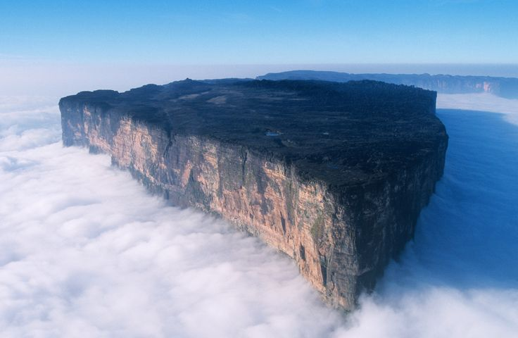 Mount Roraima is a mountain range that borders Venezuela, Brazil, and Guyana. What's unique about this mountain is its flat, tabletop surface, which in the midst of clouds looks like something really magical.