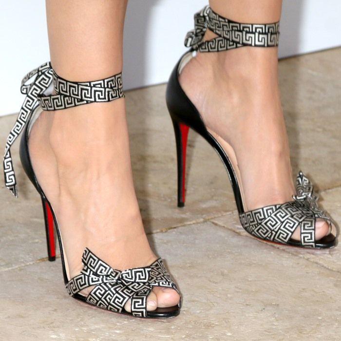 Camilla Belle wearing Greek-inspired Christian Louboutin 'Christeriva' sandals