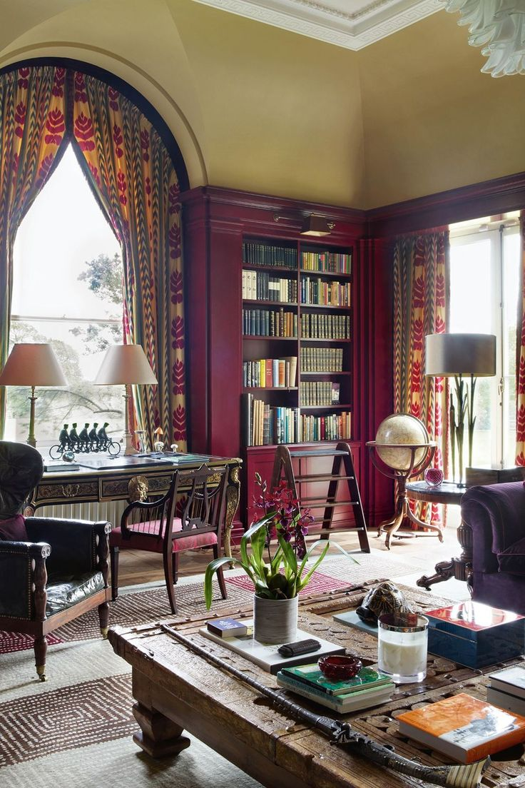 "This traditional library incorporates both modern and eclectic elements. The leather chair, curtains in Claremont's 'Concini Fleru Rouge' and globe compliment the rich colour of the bookshelves. Excellent joinery craftsmanship has been used to utilise the corner space of the room. [i]Taken from the March 2015 issue of House & Garden.[/i] Like this? Then you'll love[link url=""http://www.houseandgarden.co.uk/interiors/living-room""]Ideas for living rooms[/link]"