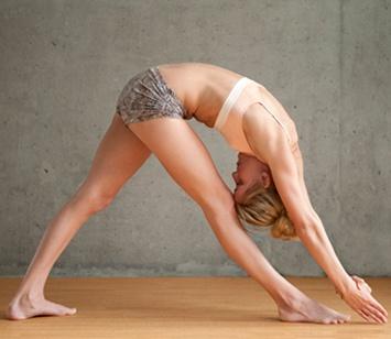 yogi sadhu in yoga position standing with leg behind the head, nepal