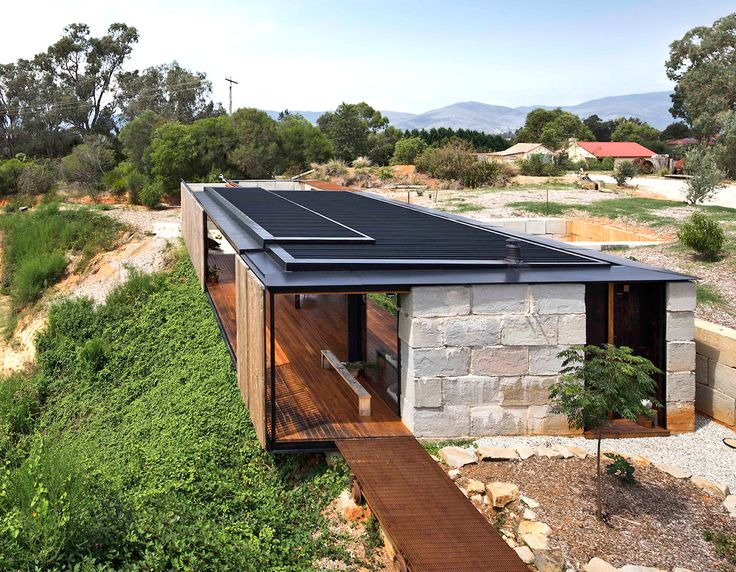 Industrial modern Sawmill House is built from recycled concrete blocks