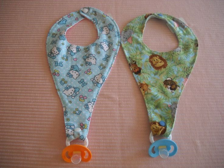 Pacifier / Binkie Bibs ~ I have got to make some of these. Or if someone wants to make me some and send them to me I am cool with that. I prefer snaps! :o) so much easier then the paci clip!