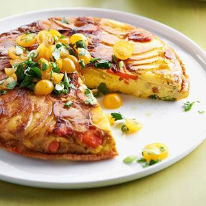 This luscious egg breakfast recipe features crisply browned potatoes and colorful fresh vegetables, including carrots, green onions, and tomatoes. Slice the potatoes and carrots thinly, about 1/8 inch, to ensure they become tender and golden during cooking.