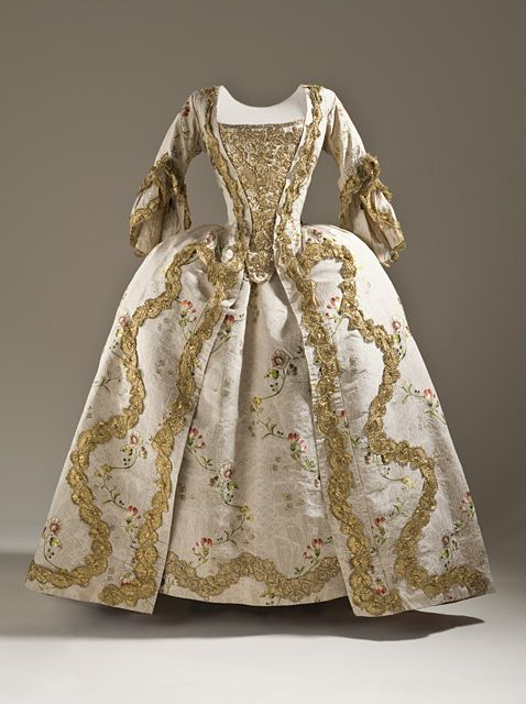 Robe à la Française    1760-1765    The Los Angeles County Museum of Art    This is the closest to Annorah's wedding dress. There would be scarlet roses between the two rows of gold embroidery and on the hem. The stomacher would also have scarlet roses stitched in.