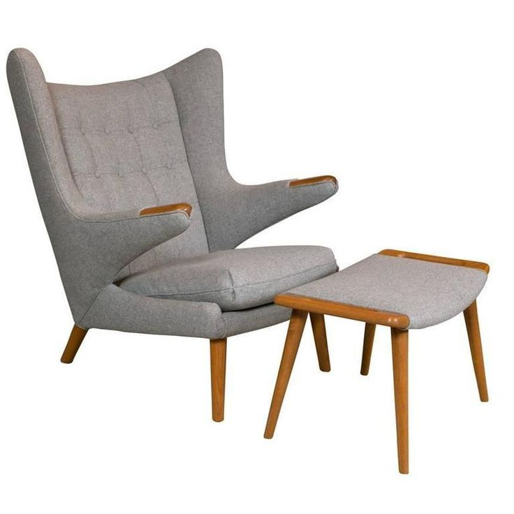 A fantastic Mid-Century Papa Bear chair with stool by Hans Wegner, designed in 1951 and manufactured by AP Stolen. The stool has the AP Stolen stamp along with the number 20 under the front rail. The ottoman is stamped 29 along with the A.P. Stolen manufacturing mark. All are newly upholstered in gray wool fabric and polished with teak oil.  Circa 1950's.  37.5 D x 35.5 W 40 H
