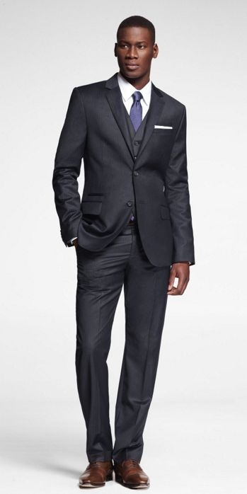 fitted navy pinstripe suit with brown shoes
