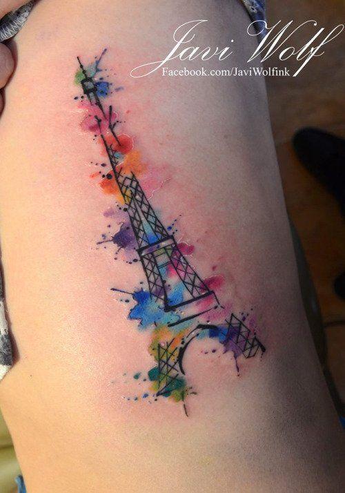 Watercolor Eiffel Tower tattoo by Javi Wolf.