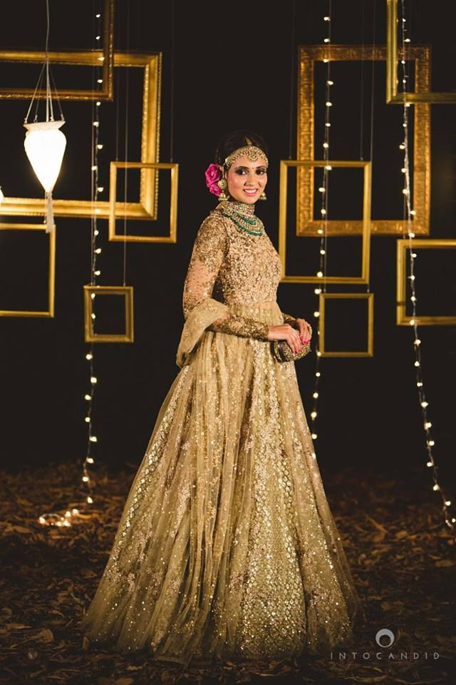 This beautiful Jacket lehenga in gold with heavy embroidery and sequins is like a dream. We love how beautiful the bride looks in this shot