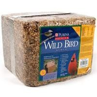 Purina Mills Premium Wild Bird Food Block 20 lb. Complement traditional feeders with pressed seed blends. Pressed seed products like energy-rich suet cakes and pressed blocks help provide more balanced nutrition. Pressed seed feeders typically attract: Chickadees, titmouse, nuthatches, wrens and other small, clinging birds, woodpeckers, cardinals, blue jays, thrushes, orioles, grosbeaks.