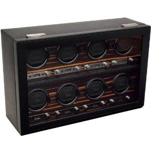 """Wolf Designs 459356 Roadster 2.7 Eight Module Cover Ebony Watch Winder Wolf Designs. $2400.00. Lock-in cuff designed to fit larger, heavier watches. Clicks and """"locks"""" into the turning drum for a secure hold. Program start delay settings from 6 hours to 72 hours. Rotation Settings from 300-1200 Turns per Day and Directional Setting options of clockwise, counter-clockwise and bi-directional. Individual options of rotation and direction settings combine to offer 57 personal progr..."""