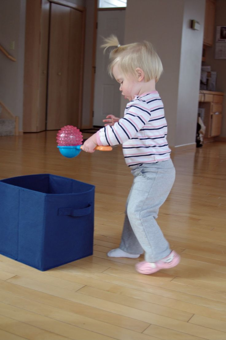 Walk across the room to transfer balls from one bin to another.
