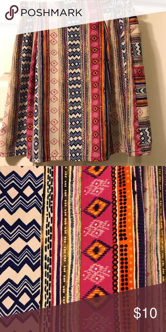Bright Patterned Skirt Size Medium NOT stretchy Brightly colored Aztec print skirt. Waistband has some stretch but skirt does not. Fits like a small/medium Skirts Midi