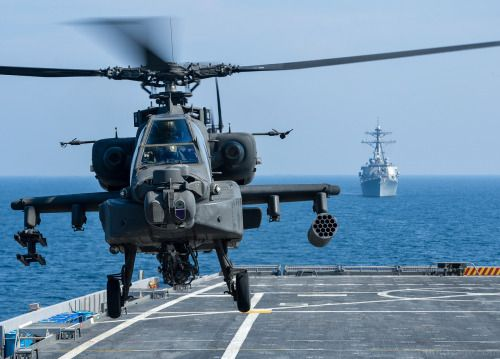 U.S. 5TH FLEET AREA OF RESPONSIBILITY (Nov. 11 2012) A U.S. Army AH-64D Apache helicopter takes off from Afloat Forward Staging Base (Interim) USS Ponce (AFSB(I) 15) during an exercise as the guided-missile destroyer USS Benfold (DDG 65) transits nearby. Ponce formerly designated as an amphibious transport dock ship was converted and reclassified to fulfill a long-standing U.S. Central Command request for an AFSB to be located in the U.S. 5th Fleet area of responsibility. The U.S. Navy is…