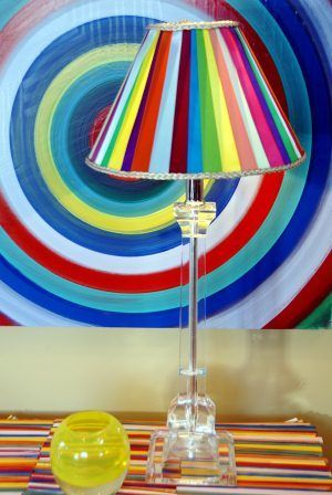 Use ribbon scraps to cover a lampshade with color. This lamp shade will match practically any room.
