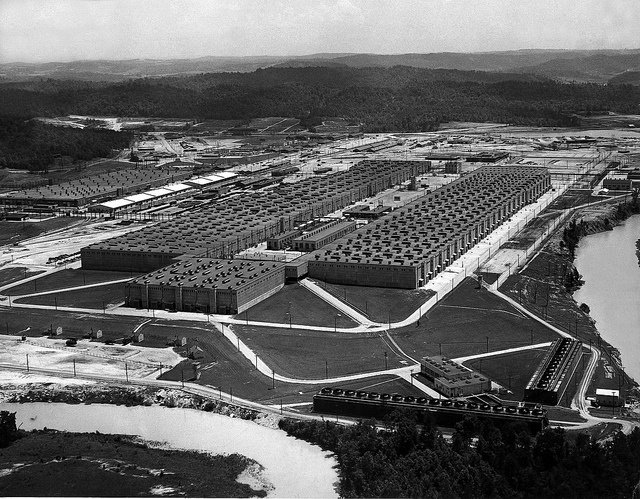 1947 aerial view of the K-25 uranium enrichment building in Oak Ridge, TN. Both the building and city were built for the Manhattan Project. From the DoE archives.