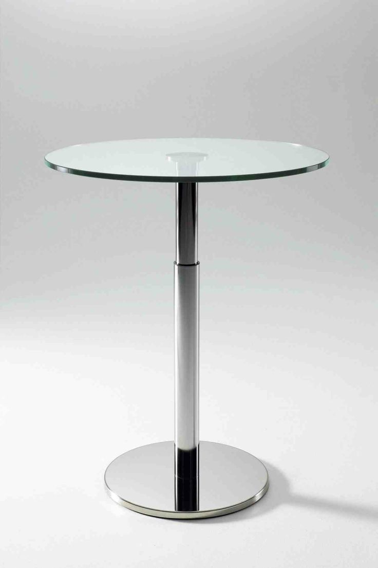 Height adjustable Bobine Table. Clear Glass top 80cm dia. Base in chrome, Height 73/98 cm.