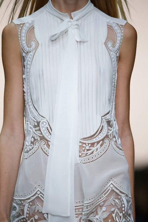 White sleeveless dress with pleats & embroidery