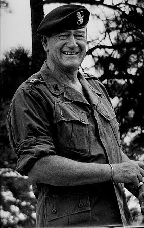 "John Wayne on location for ""The Green Berets,"" 1967. Vintage silver gelatin, 14x11, signed. $750 © 1978 David Sutton MPTV"