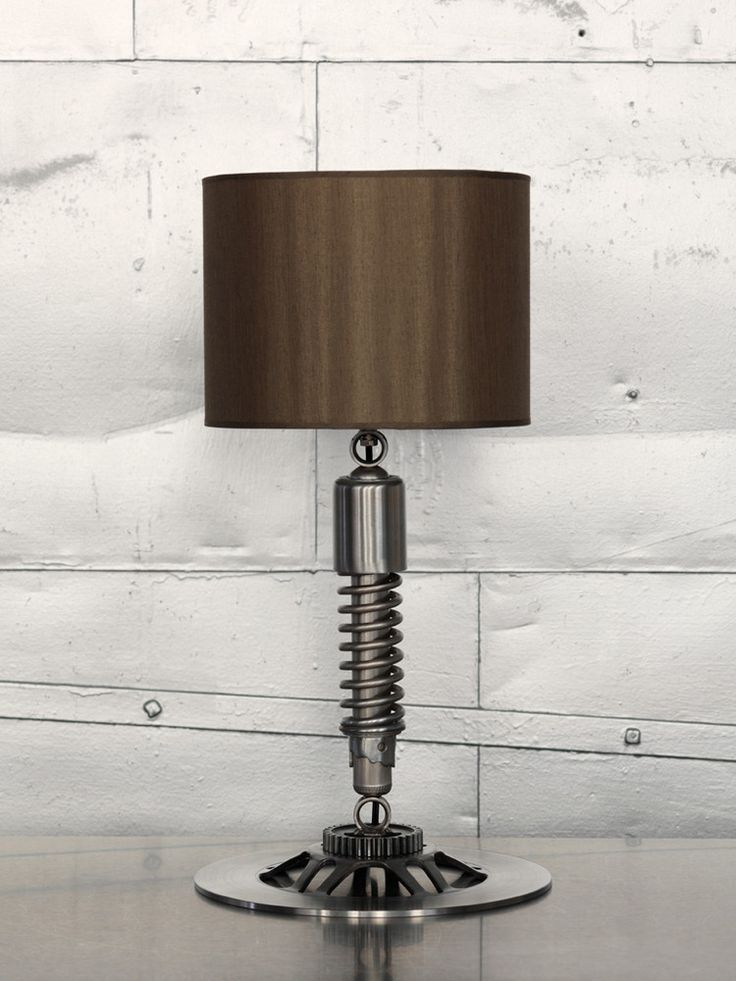 use of a cruisers coil over shock and brake rotor to make a table lamp for your Man Cave