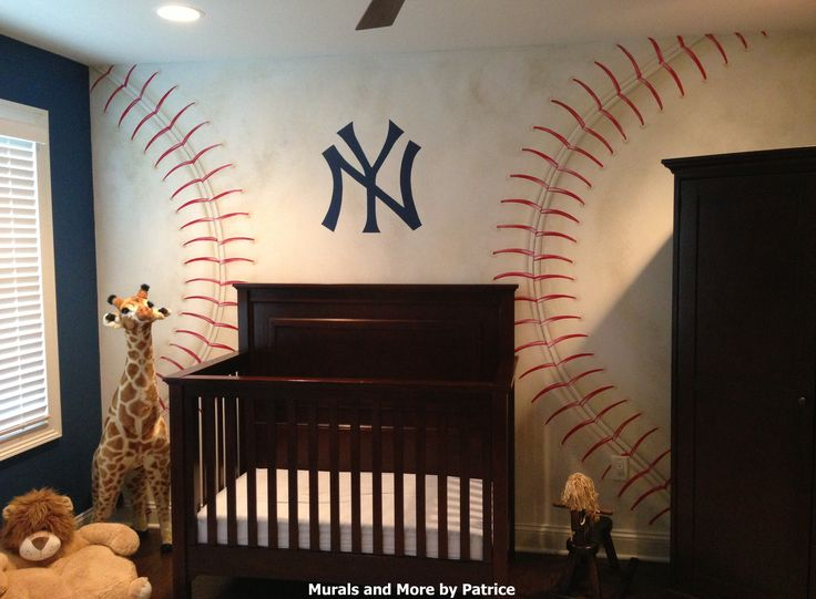 A NY Yankees nursery featuring a NY Yankees hand-painted baseball wall mural and 3 lockers with dad's favorite Yankee players jerseys.