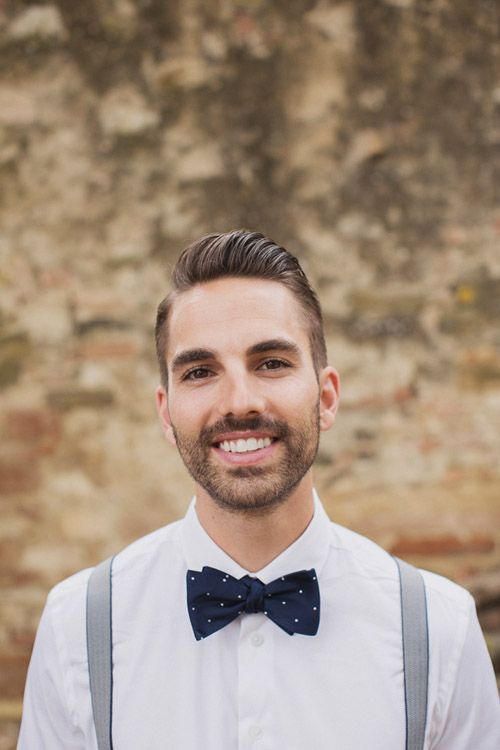 stylish grrom in navy bow tie and suspenders at a destination wedding in Italy - photo by Whitewall Photography | junebugweddings.com